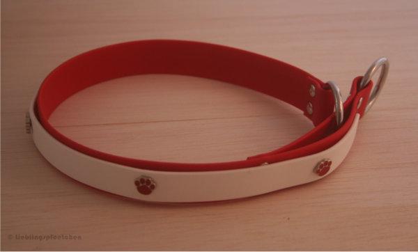 Rot-weißes Zugstopphalsband mit roten Ziernieten in Knochenform